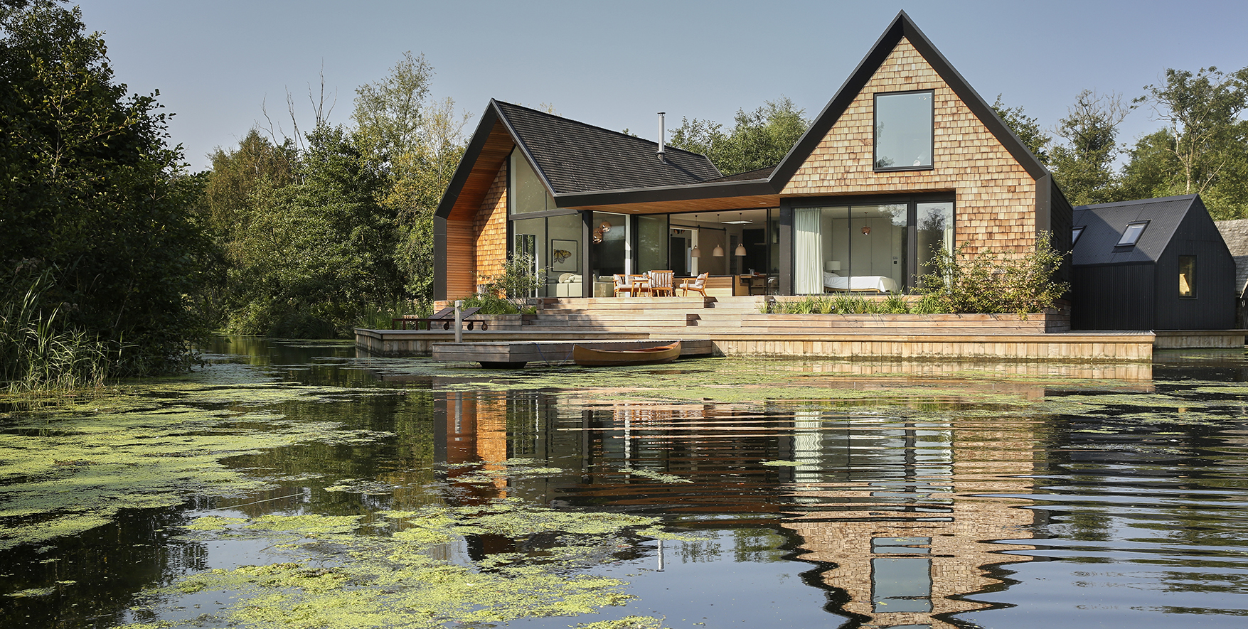 A vacation home in the Norfolk Broads featuring the Axel sliding door hardware from Krownlab