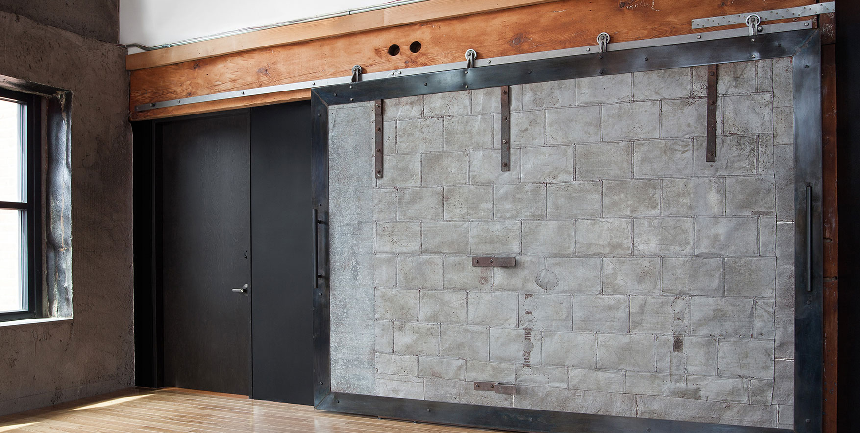 Axel Raw Steel Flat Track Sliding Barn Door