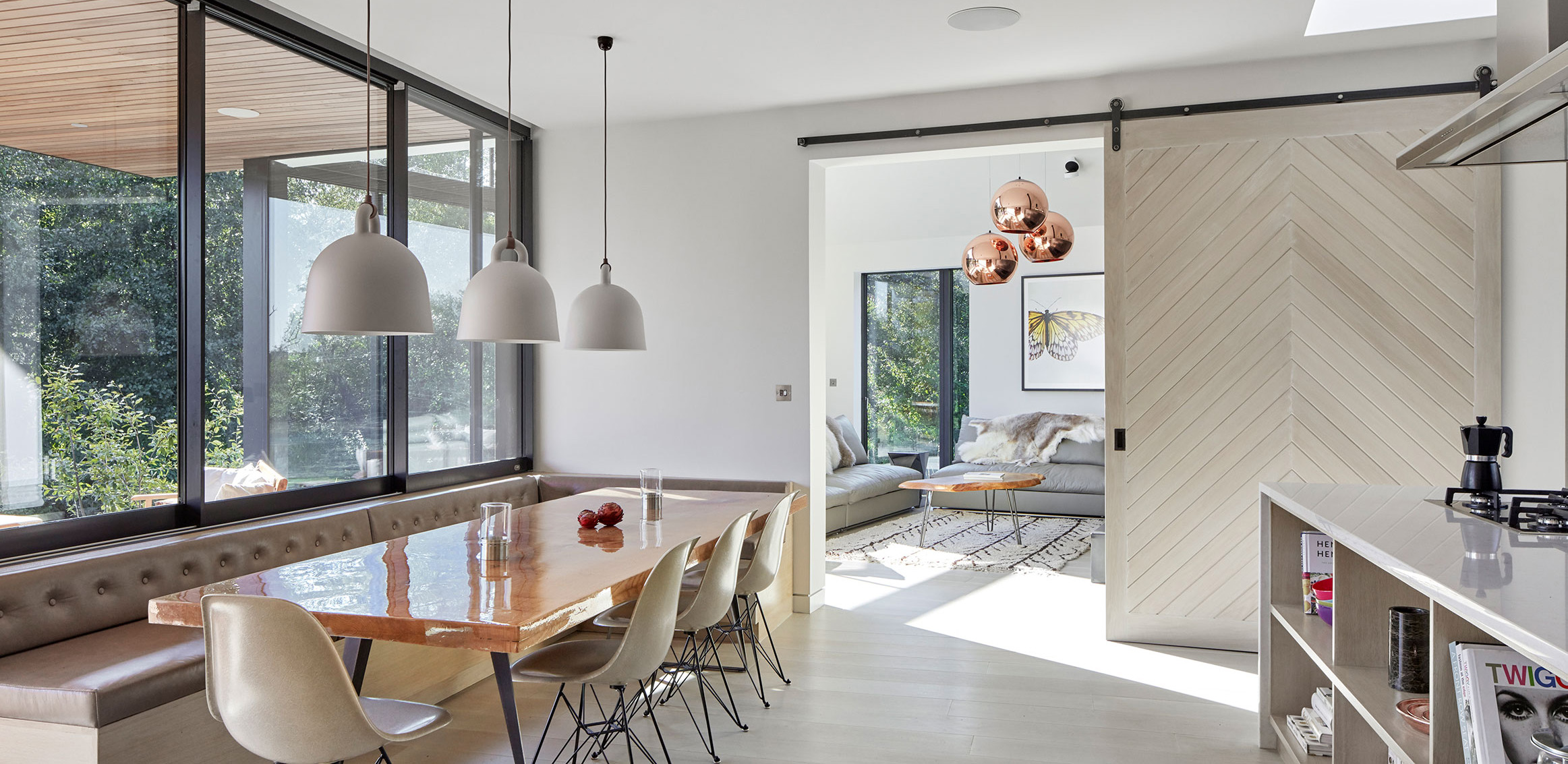 Axel-interior-sliding-barn-door-hardware-in-raw-steel-finish-installed-in-modern-dining-room