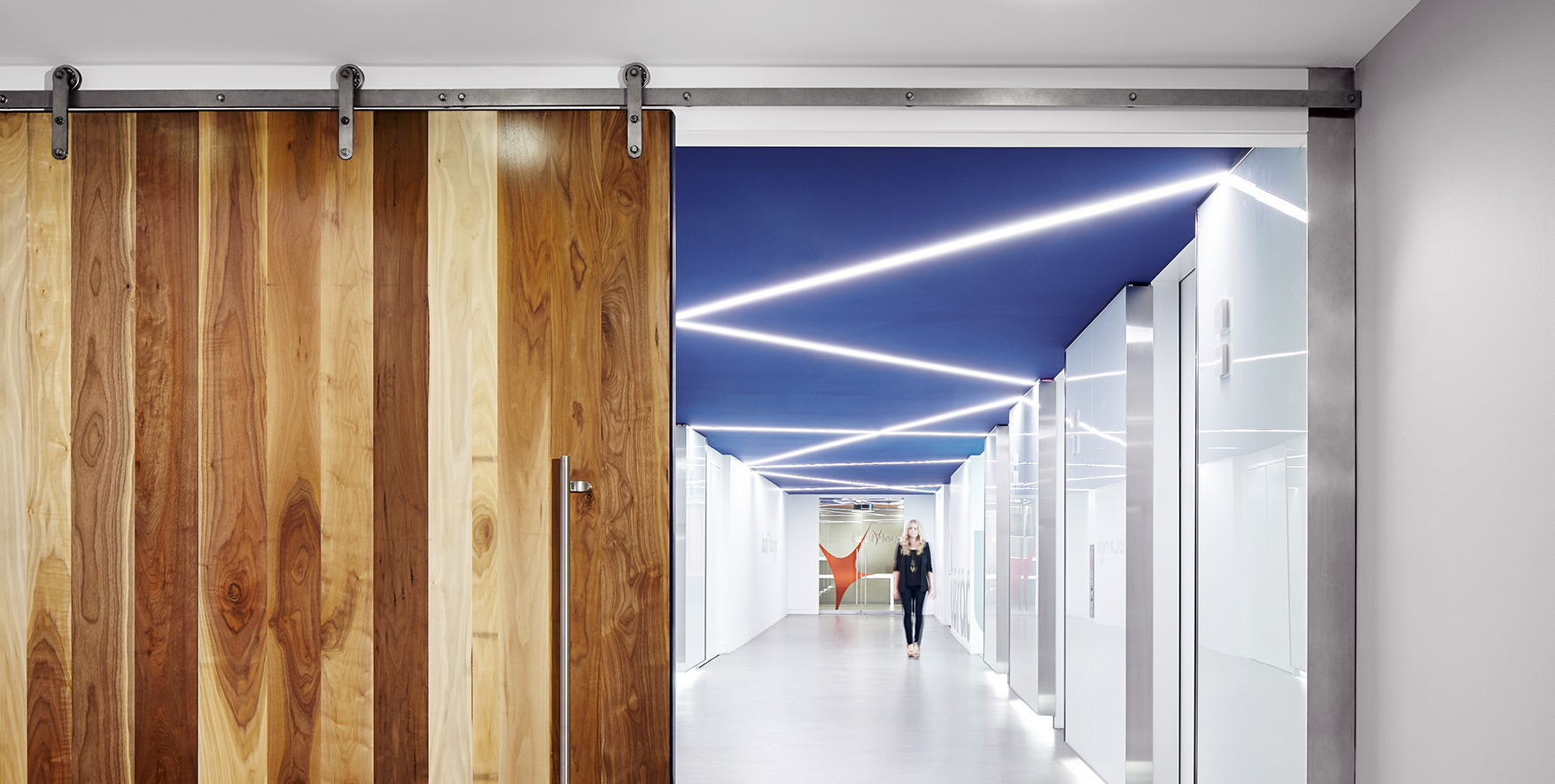 Axel-flat-track-sliding-barn-door-hardware-in-raw-steel