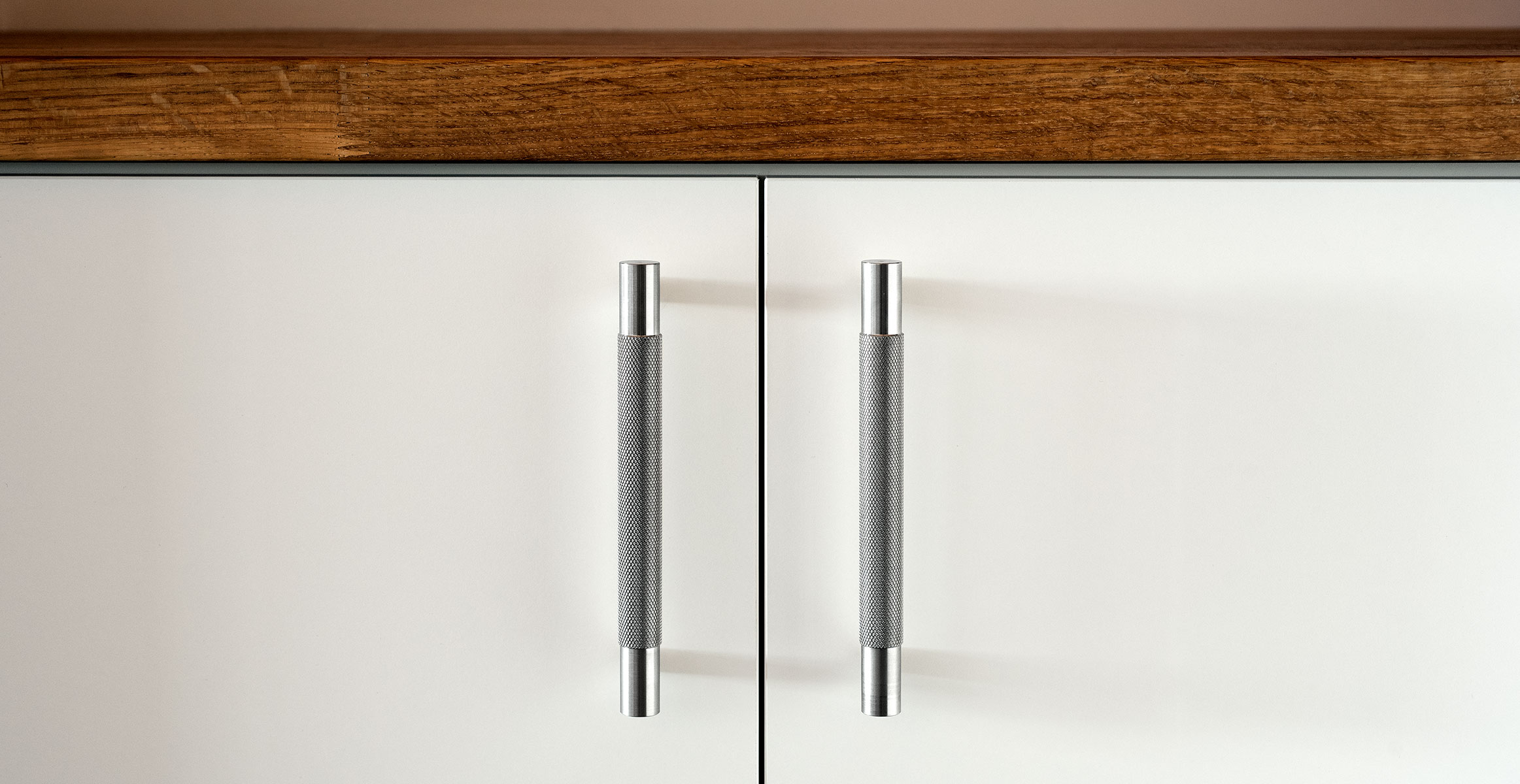 Kor cabinet pulls in stainless finish installed on kitchen cabinet