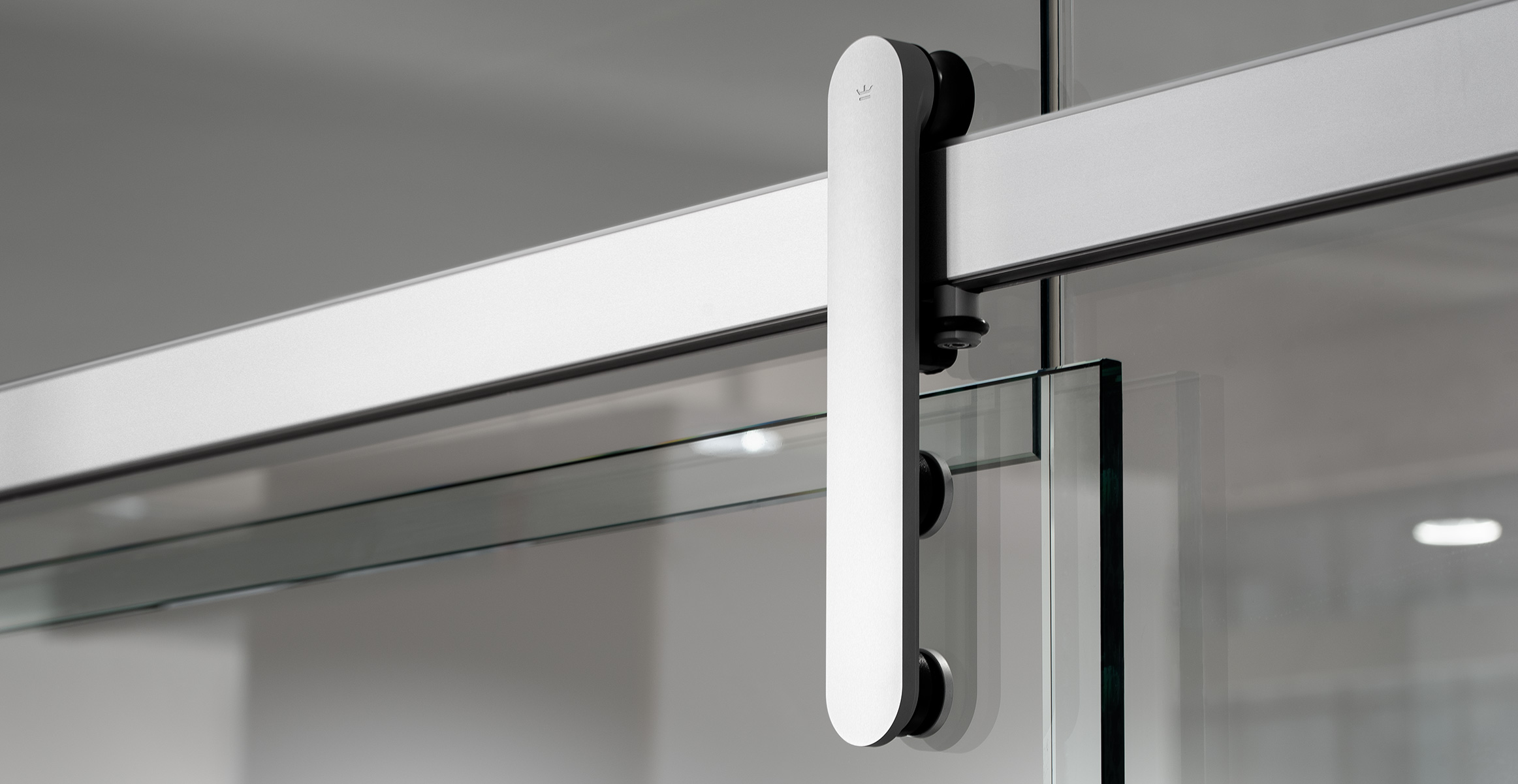 Loki sliding door hardware installed on glass office wall