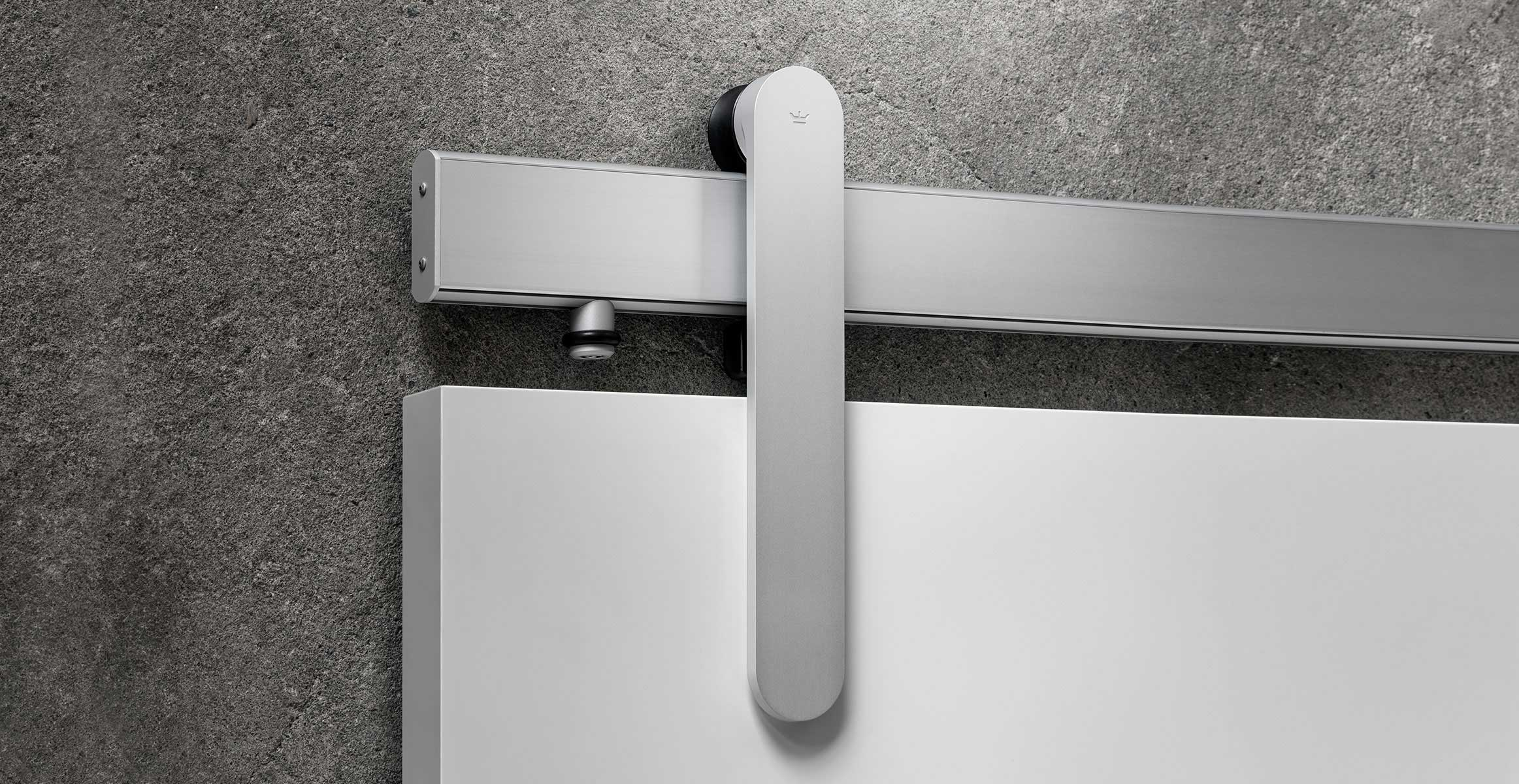 Loki sliding door hardware in Satin Silver finish with white door panel