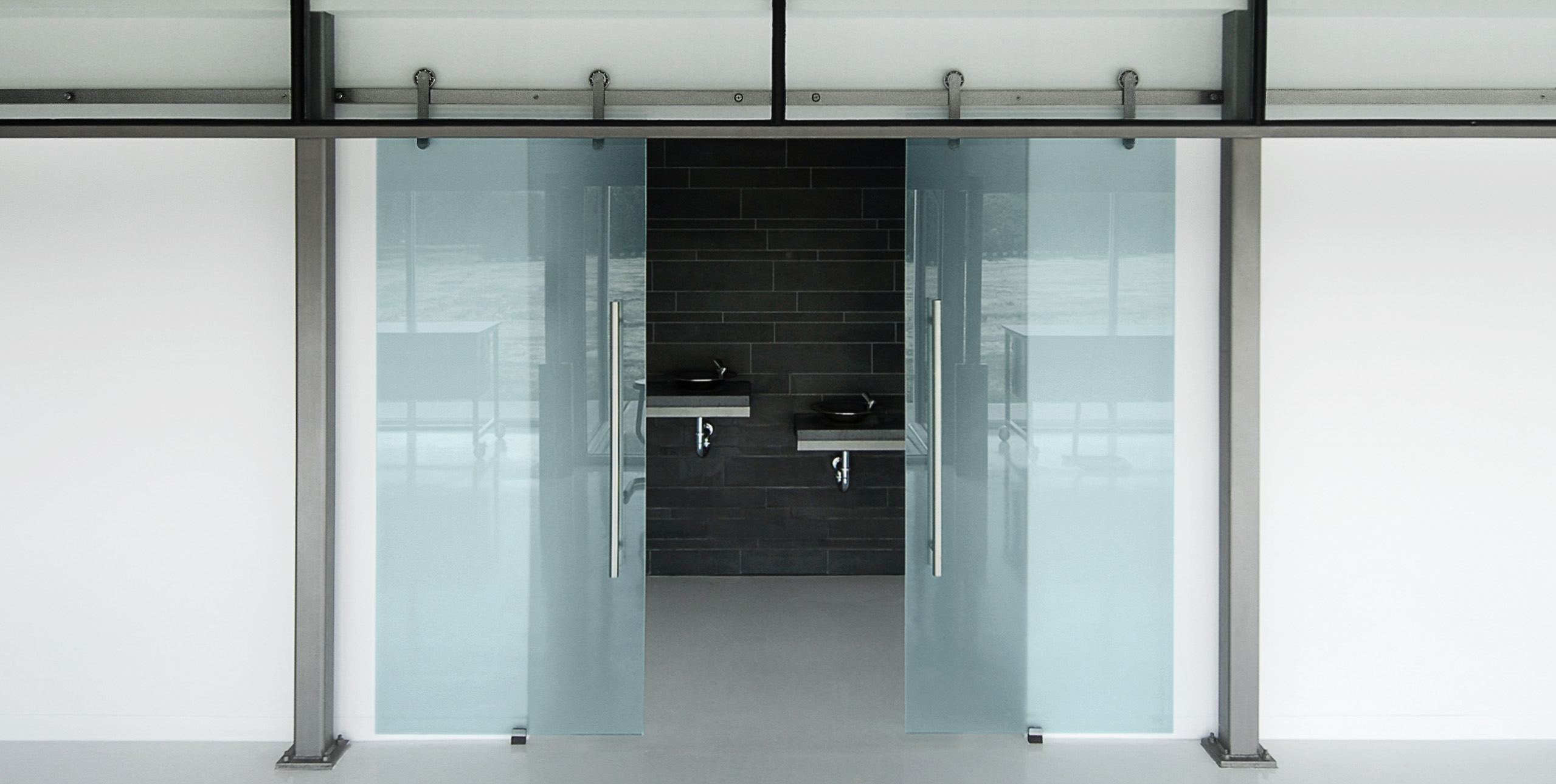 Oden-stainless-steel-sliding-door-system-in-face-mount