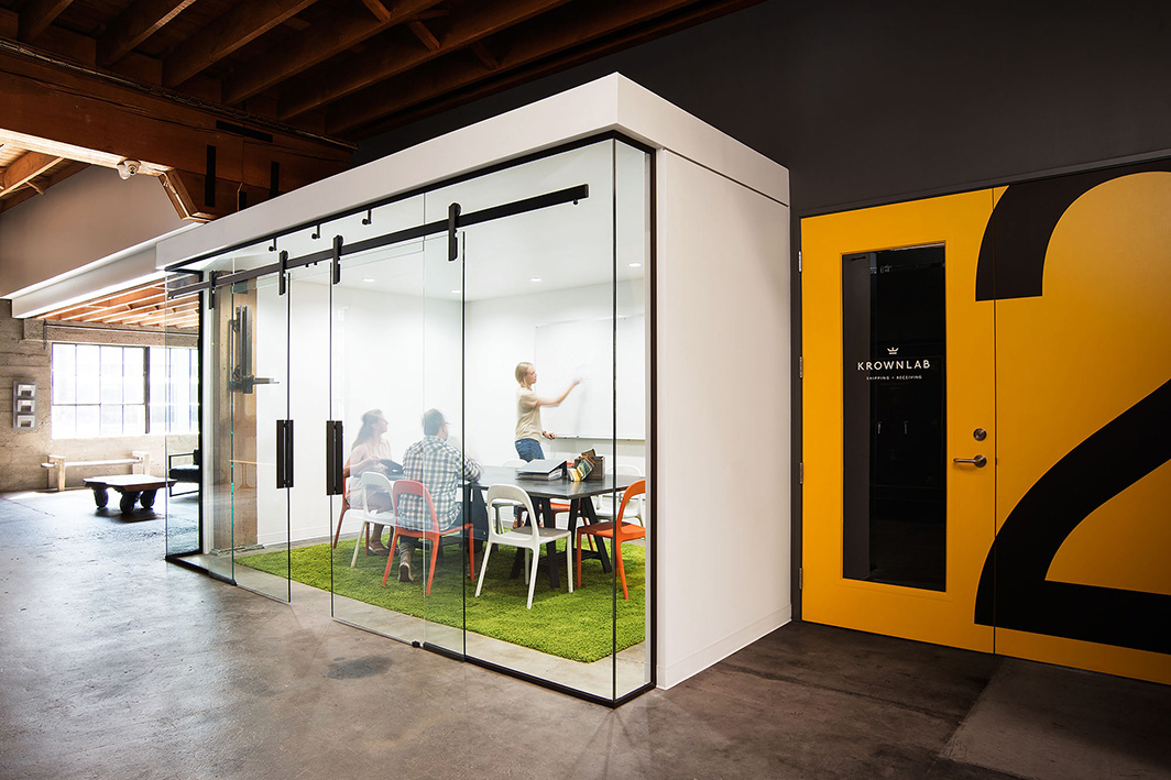 Office conference room in Krownlab headquarters with modern sliding door hardware