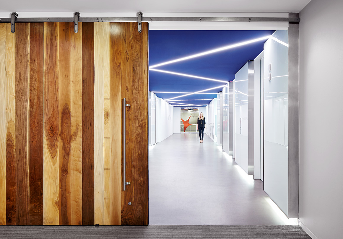 The Axel sliding door hardware system in Rise Interactive's Chicago, IL headquarters. Shown in Raw Steel.
