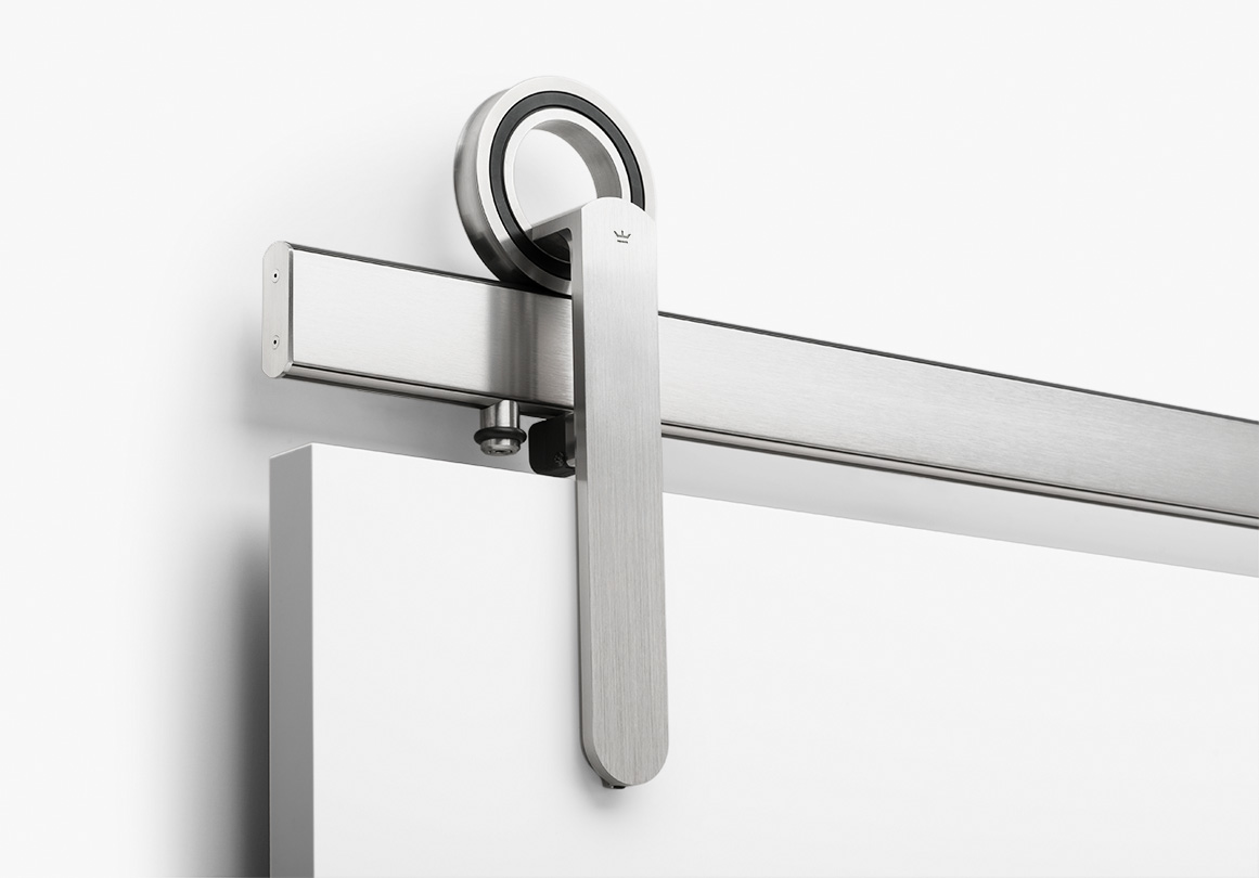 Baldur sliding door hardware in Brushed Stainless finish.