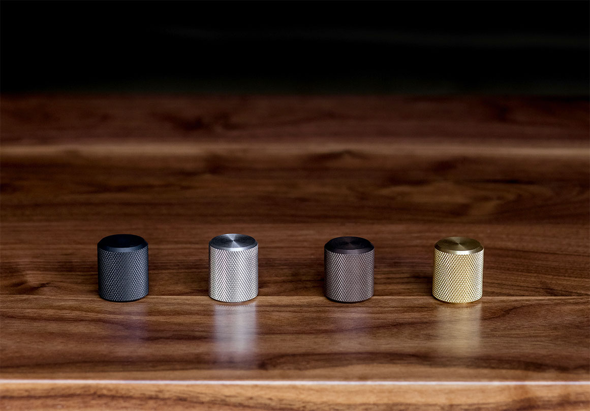 Kor Furniture Pull in Black Stainless, Brushed Stainless, Aged Bronze and Brass finish.