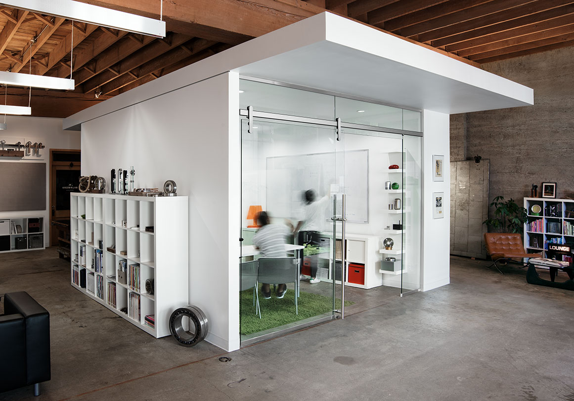 The Loki sliding door hardware system in Krownlab's headquarters, Portland, OR. Shown in Glass Mount with Satin Silver finish.