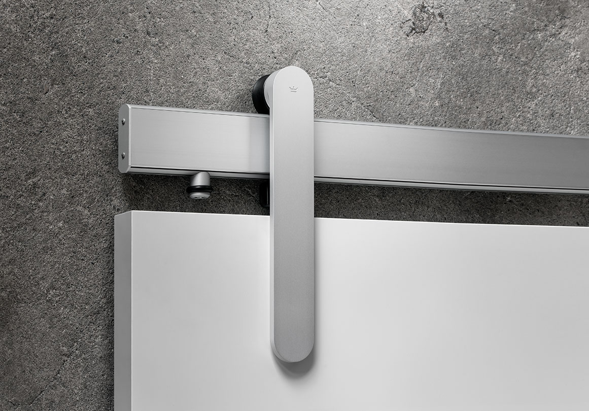Loki sliding door hardware in Satin Silver finish with white panel.