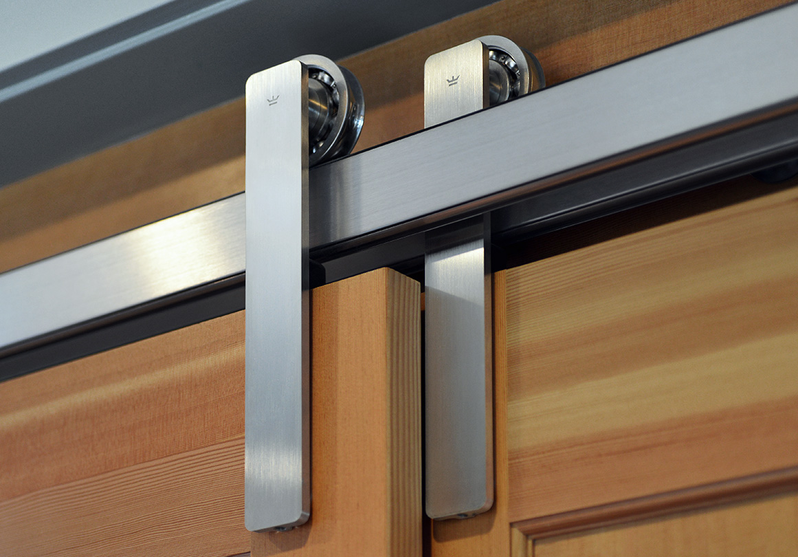 Oden sliding door hardware provided the best solution for this narrow space closet doors.