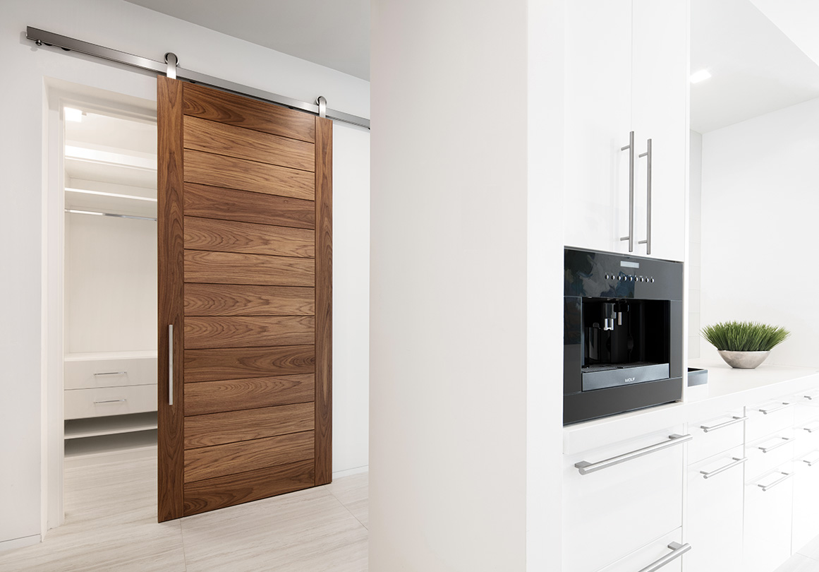 Oden sliding door hardware installed in a private residence.  Shown in Top Mount with Brushed Stainless finish.