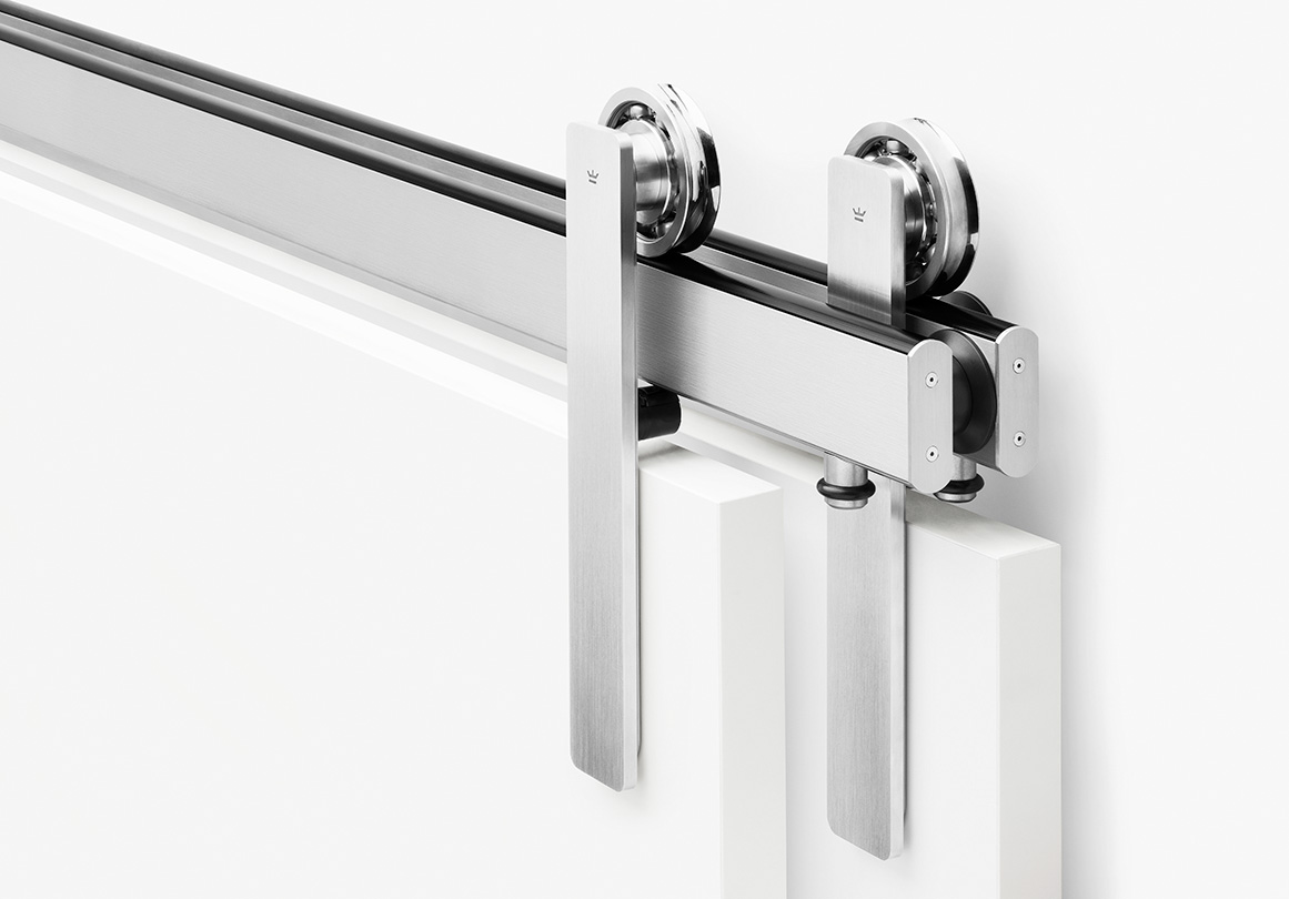 The Ragnar sliding door hardware system in bypass configuration and Brushed Stainless finish.