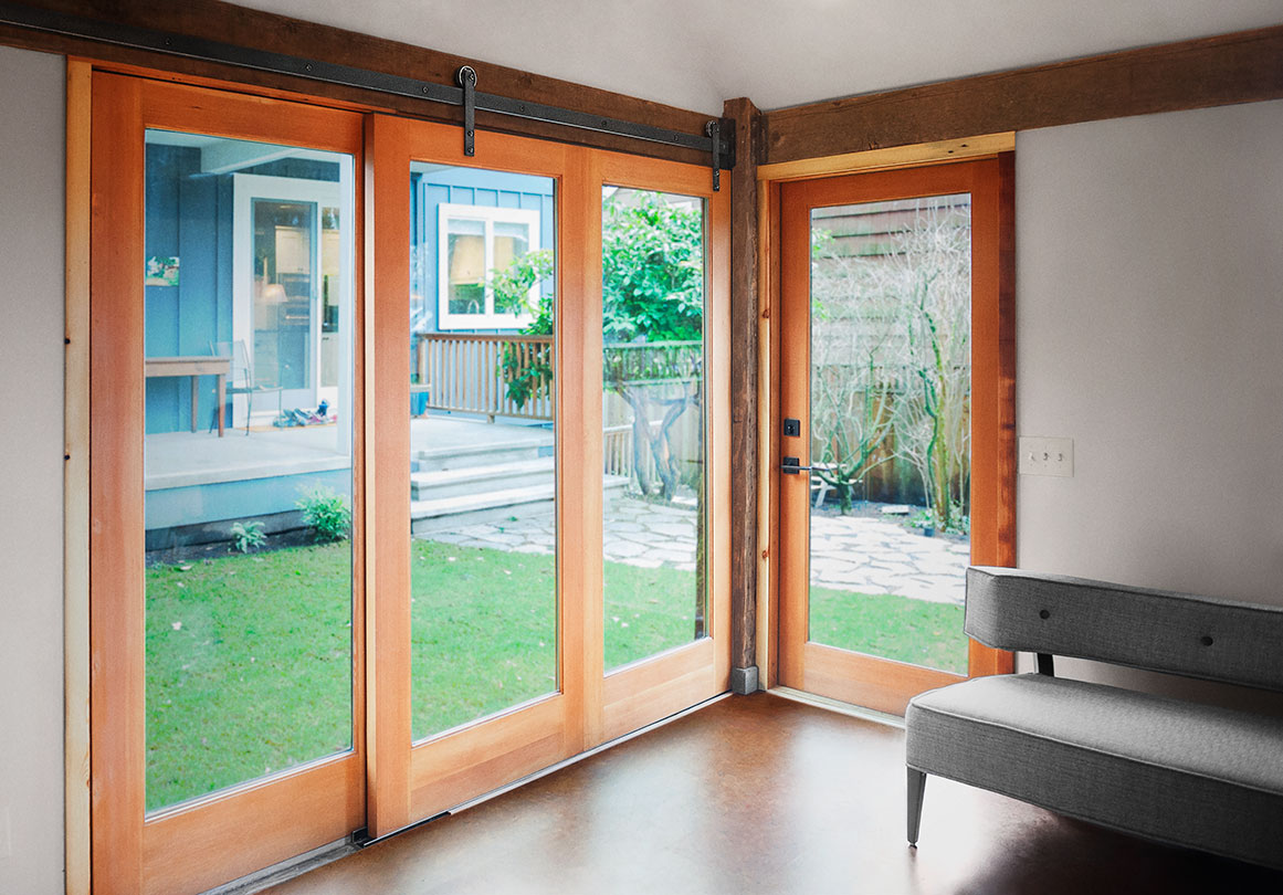 The Rob Roy sliding door hardware system in a Quartertwenty-designed studio, Portland, OR. Shown in Face Mount with Black Stainless finish.