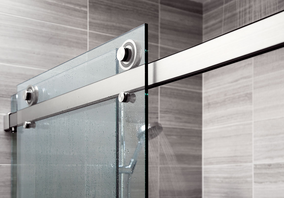 Rorik sliding shower door system in Doppelganger Duplex, Portland, OR.  Shown in Alcove with Brushed Stainless finish.